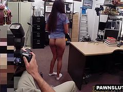 Brunette babe plays with her pussy at the pawn shop