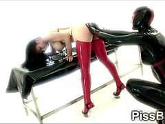 Big stacked brunette masochist in sexy latex suit gets punished