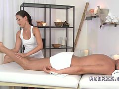Masseuse gives oiled cock massage and fucks customer